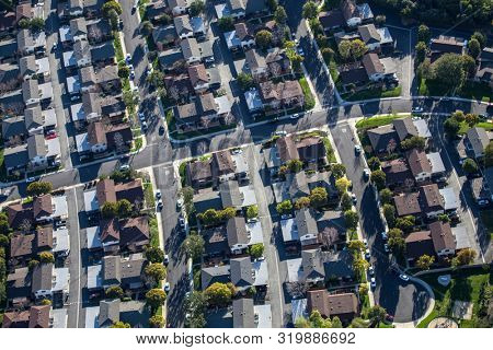 Aerial view of suburban cul-de-sac streets, apartments and houses near Los Angeles in Ventura County, California.