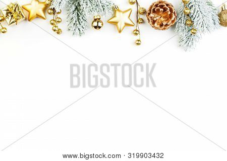 Christmas Border Composition. Gold Decorations And Green Fir Branch On White Background. Xmas Flat L