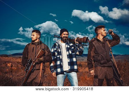 Hunters Men. Group Of Hunters With A Hunting Gun And Hunting Form To Hunt In Forest. Group Hunting.