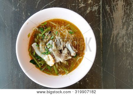 Spicy Seafood Noodles Soup With Pork Bone Crayfish, Shrimp.  Asia Food In Pink Bowl On Wooden Table