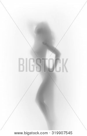 Beautiful And Sexy Nude Woman Stands And Poses Behind A White Textile Curtain. Perfect Body Shape Si
