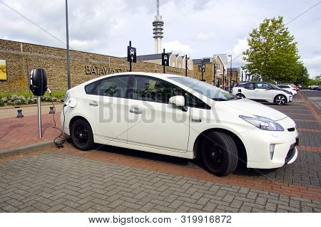 Lelystad, The Netherlands - September 1, 2019: White Toyota Prius Being Charged On A Public Parking