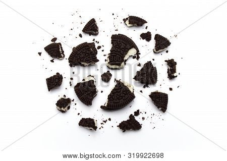 Oreo Biscuits With Crumbs On White Background. It Is A Sandwich Cookies Filled With Chocolate Cream