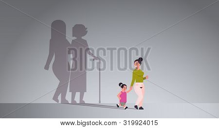 Mother With Daughter Holding Hands Shadow Of Young And Mature Woman Standing Together Imagination As