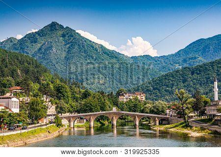 Konjic, Bosnia And Herzegovina - July 18, 2019. Old Stone Bridge Above River Neretva
