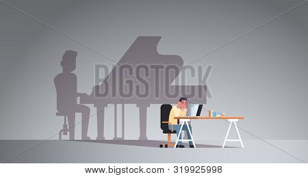 Overworked Man Sitting At Workplace Using Laptop Shadow Of Man Playing Piano Imagination Aspiration