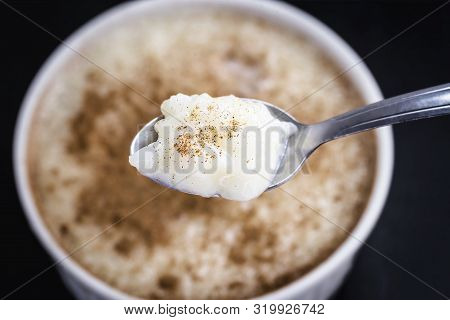 Spoon With Rice Pudding And Cinnamon. Typical Dessert From Brazil, A Tasty Porridge.