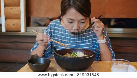Woman eat with famous vegetable noodles in Kawaguchiko of Japan