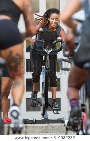 Atlanta, Ga / Usa - September 15:  An Instructor Leads An Outdoor Spin Class As Part Of The Pretty G