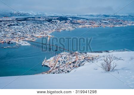 Aerial View To The City Of Tromso In Winter From The Mountain Ledge Storsteinen, 421 M Above Sea Lev