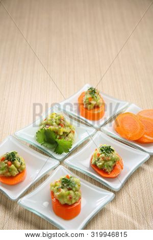 Carrot Entrees With Guacamole, Presentation Of Catering For Celebration. Served On Colored Tableclot