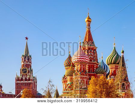 Spasskaya Tower Kremlin And Saint Basil Cathedral Red Square In Moscow, Russia Autumn