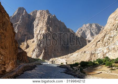 Pamir Highway M41 International Road Or Pamirskij Trakt. Panj River And Pamir Mountains. Panj Is Upp