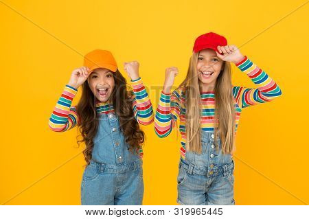 Happiness Ahead. Happy Small Girls Enjoying Happiness Together On Yellow Background. Little Kids Wit