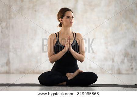 Young Woman Practicing Yoga, Padmasana Exercise, Lotus Pose