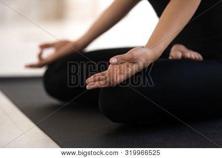 Woman Sitting In Lotus Pose Close Up, Practicing Yoga, Padmasana Exercise