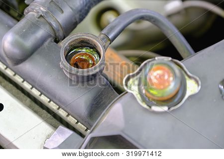 Be Careful Engine Concept, Check The Water Level In A Car Radiator
