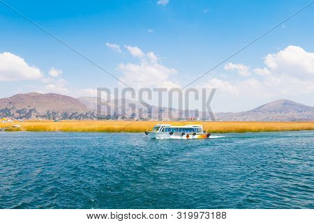 Titicaca Lake Peru, August 16 Tourists Cross The Lake On A Straw Boat During An Excursion Shoot On A