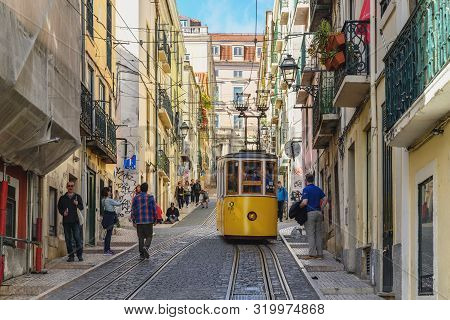 Lisbon, Portugal - April 10, 2019: Lisbon Portugal City Skyline At Chiado District And Tram