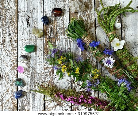 Herbal Scrolls And Reiki Crystals On Wooden Planks. Esoteric, Occult And Mystic Concept, Alternative