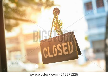 Closed Sign Hanging Front Of Cafe With Colorful Bokeh Light Background. Business Service