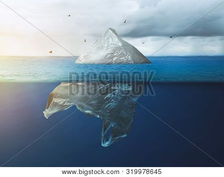Global Warming In The Arctic. Plastic Bag Iceberg With The Bird, Environment Pollution