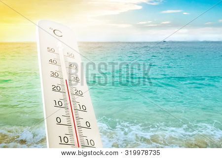 Heat Wave On The Beach Thermometer Shows In Summer.