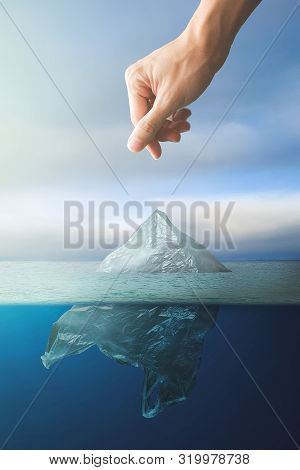 Hand Throwing Plastic Bag Floating In Ocean, Environment Pollution