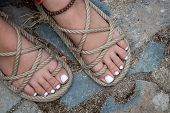 Beautiful and white polished toenails of a young teenage girl. poster