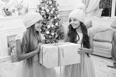 Children friends excited unpacking their gifts. Kids little sisters hold gifts boxes interior background. What a great surprise. Small cute girls received holiday gifts. Best toys and christmas gifts. poster