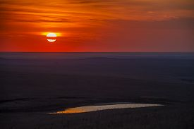 Sunset Over The Flint Hills Of Kansas; Small Pond Reflection
