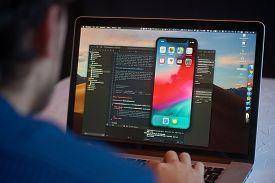 Bishkek, Kyrgyzstan - January 17, 2019: Man Developer Launches Xcode Software And Ios Simulator Prog