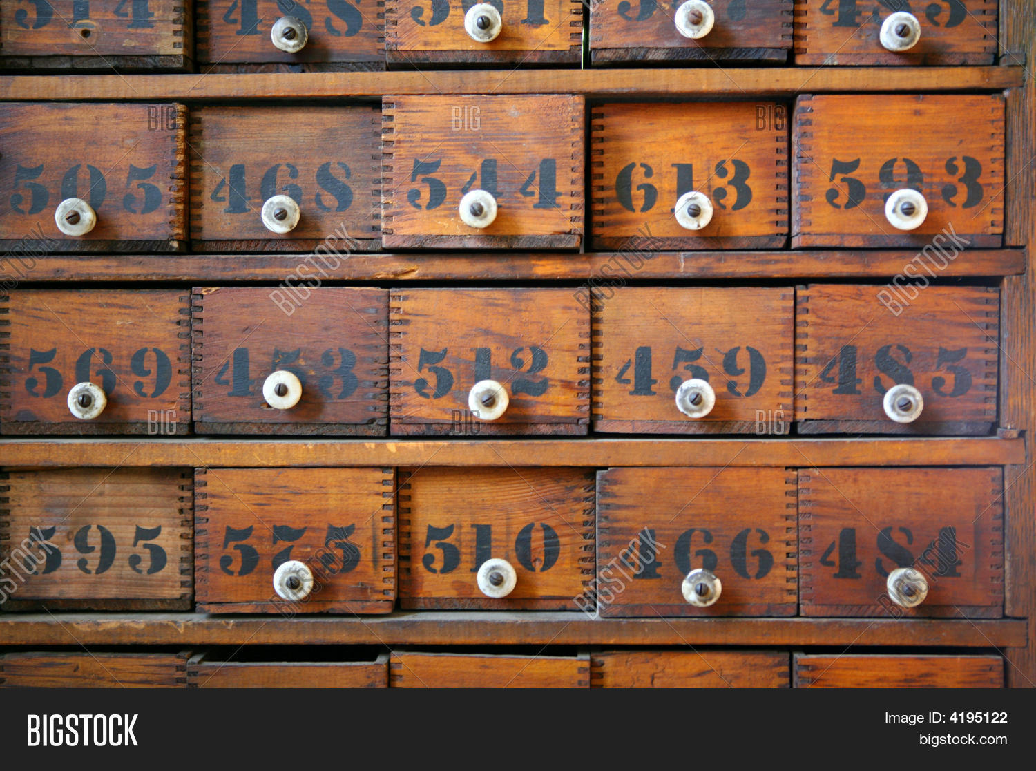 Antique wooden medicine cabinet with numbered drawers and white knobs. - Antique Wooden Image & Photo (Free Trial) Bigstock