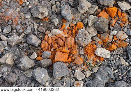 Background Of Dark Gray And Orange Stones. Full Frame.