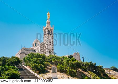Marseille, France. Catholic Basilica Of Our Lady Of The Guard Or Notre Dame De La Garde Church At Hi