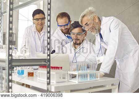 Medical Research Laboratory. A Group Of Researchers Are Working In A Modern Lab.