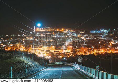 Stepantsminda, Georgia. New Road To Sameba. View On Countryside Village At Evening Night Time. Kazbe