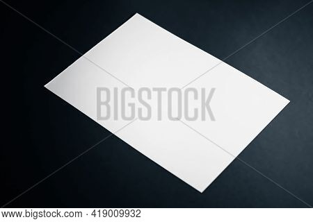 Blank A4 Paper, White On Black Background As Office Stationery Flatlay, Luxury Branding Flat Lay And