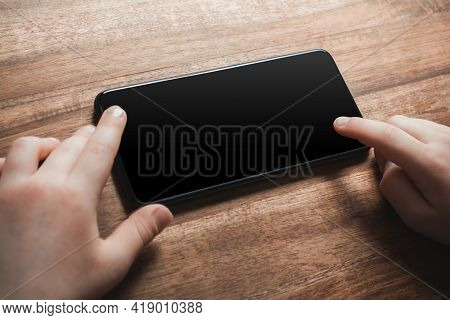 Child Using Blank Smartphone Screen With Copy Space - Prevent Child Smartphone Addiction Concept