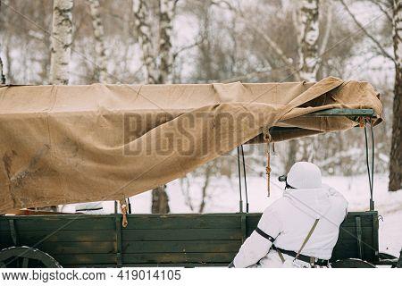 Hidden Re-enactor Dressed As German Wehrmacht Infantry Soldier In World War Ii Sitting In Ambush Nea