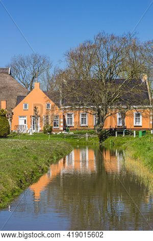 Colorful Farmhouse Refleted In The Water In Den Horn, Netherlands