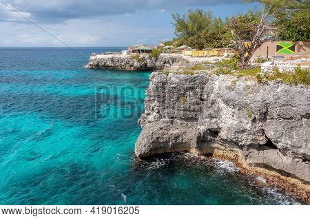 Caribbean Rocky Beach With Turquoise Water In Negril, Jamaica