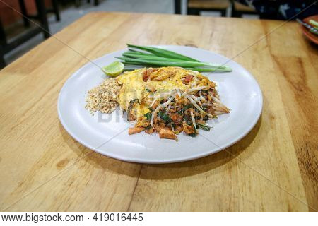 Pad Thai Noodles On The Wooden Table
