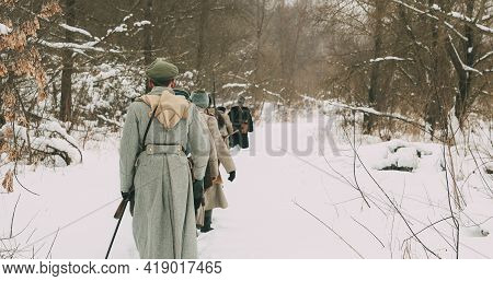 Men Dressed As White Guard Soldiers Of Imperial Russian Army In Russian Civil War Times Marching Thr