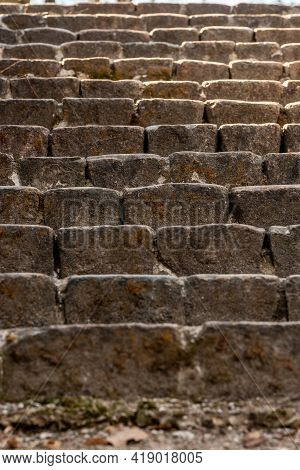 Vertical Close-up Photo Of An Ancient Stone Stairs. Old Brick Stone Stairs Going Up To The Sun. Brow