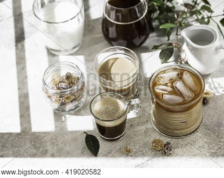 Tasty Ice Coffee With Milk, Cream And Set With Different Types Of Coffee Drinkson Gray Background Wi