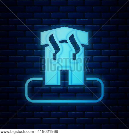 Glowing Neon Arson Home Icon Isolated On Brick Wall Background. Fire In Building. Flames From Office