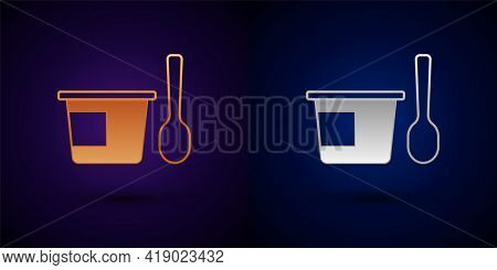 Gold And Silver Yogurt Container With Spoon Icon Isolated On Black Background. Yogurt In Plastic Cup