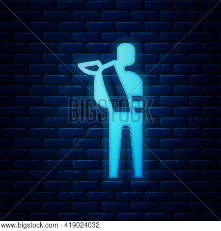 Glowing Neon Human Broken Arm Icon Isolated On Brick Wall Background. Injured Man In Bandage. Vector