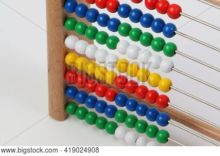Small Ruler With Colorful Wooden Balls In A White Studio